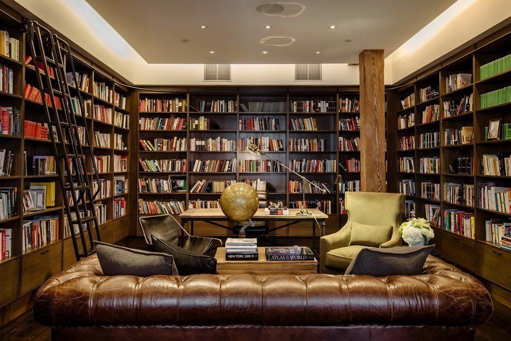 Bachelor pad ideas facebook home tour for Private library design